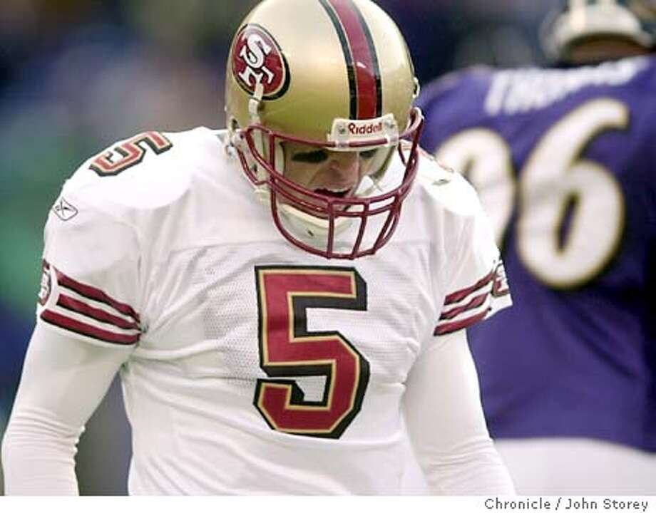 The Forty Niners lose to the Baltimore Ravens at M&T Bank Stadium. 49ers quarterback Jeff Garcia walks off the field after throwing one of his many interceptions.  11/30/03 in Baltimore. JOHN STOREY / The Chronicle Photo: JOHN STOREY