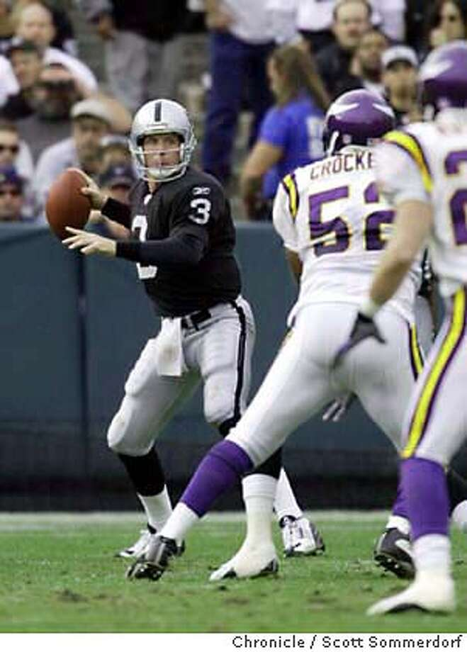 Raiders QB Rick Mirer looks for a receiver in the 3rd quarter.  Oakland Raiders vs Minnesota Vikings at Network Associates Coliseum.  Event on 11/16/03 in Oakland.  SCOTT SOMMERDORF / The Chronicle Photo: SCOTT SOMMERDORF