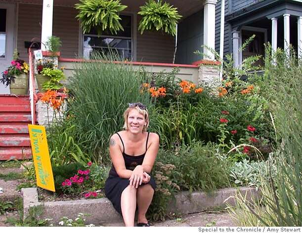 Cynnie Gaasch makes the most of her tiny front garden in Buffalo, N.Y., featured on GardenWalk Buffalo. Photo by Amy Stewart, special to the Chronicle