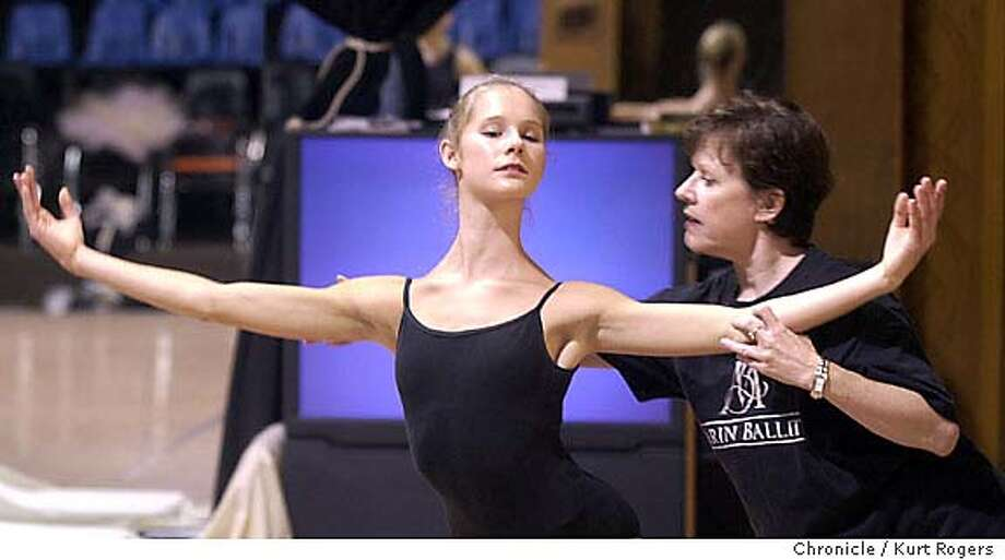 Cynthia Lucas R works with Alexendra Mccullagh on the Snow Deux  The Marin Ballet and how the community comes together to volunteer their time to put on the annual production .NUTCRACKER_kr248.JPG Event on 11/15/03 in San Rafael. KURT ROGERS / The Chronicle MANDATORY CREDIT FOR PHOTOG AND SF CHRONICLE/ -MAGS OUT Photo: KURT ROGERS