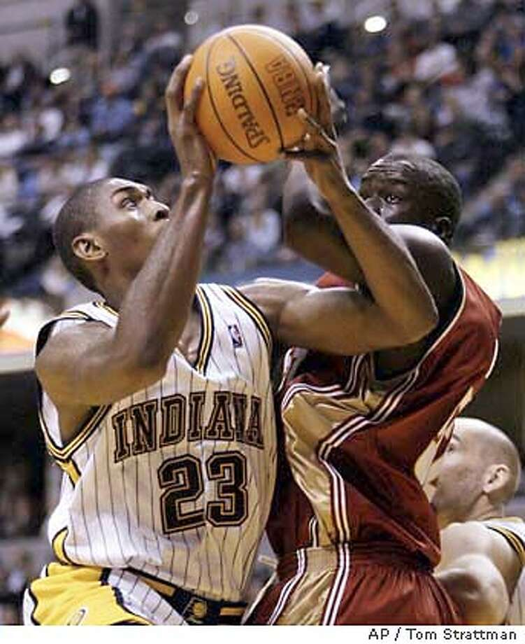 Indiana Pacers forward Ron Artest puts up a shot against Cleveland Cavaliers center DeSagana Diop of Senegal during the fourth quarter in Indianapolis on Friday, Nov. 7, 2003. Artest had 21 points in the Pacers' 91-90 win. (AP Photo/Tom Strattman) Photo: TOM STRATTMAN