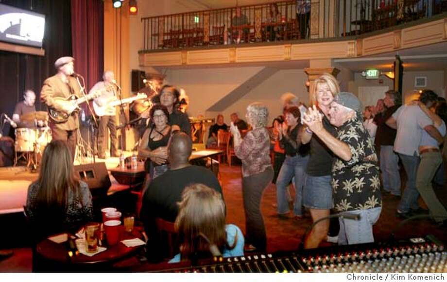 JAMCITY14_069_KK.JPG  The Steve Freund Blues Band plays and Karen Walters and Mike Monte (r) dance as musicians and blues fans flock to one of the best blues jams in the Bay Area every Wednesday night at the Little Fox Theater in Redwood City.  Photo by Kim Komenich/The Chronicle  **Mike Monte, Karen Walters, Steve Freund MANDATORY CREDIT FOR PHOTOG AND SAN FRANCISCO CHRONICLE. NO SALES- MAGS OUT. Photo: Kim Komenich