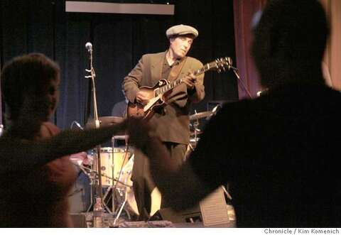 9e7d1e6ae26 JPG A couple dances in the foreground as Steve Freund solos. Musicians and