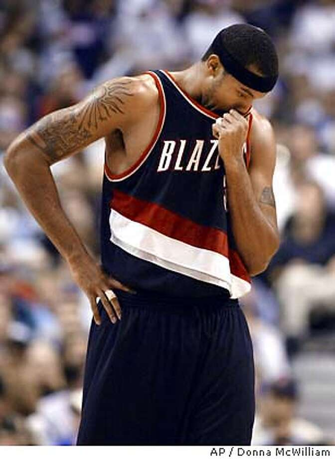 Portland Trail Blazers forward Rasheed Wallace wipes his face in the fourth quarter of their game against the Dallas Mavericks in Dallas, Monday, Nov. 17, 2003. The Mavericks won 105- 98. (AP Photo/Donna McWilliam) Photo: DONNA MCWILLIAM