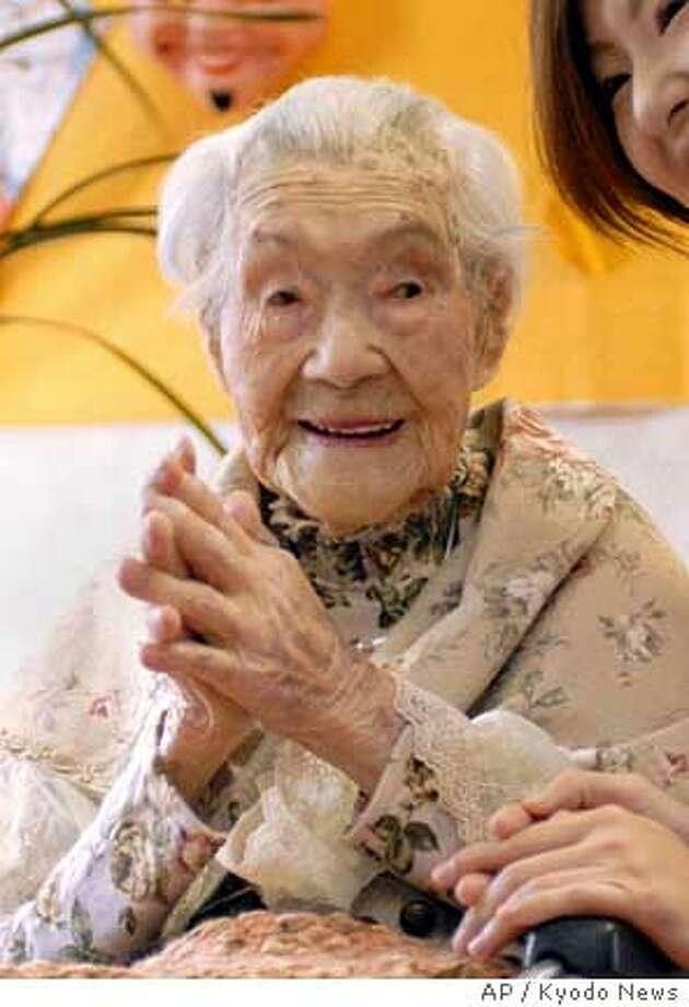Yone Minagawa, 114, now believed to be the world's oldest living person, looks on in her bed at the Keiju nursing home at Fukuchi town in Fukuoka Prefecture (state), southwestern Japan, Thursday, Jan. 4, 2007. Minagawa has a healthy appetite that's developed over the last 114 years, according to the nursing home's staff. Born Jan. 4, 1893, Minagawa has lived through four Japanese emperors and was fingered as the world's oldest person by the Guinness Book of World Records following the death Sunday, Jan. 28, 2007 of Emma Faust Tillman, also 114. (AP Photo/Kyodo News) ** JAPAN OUT NO SALES CREDIT MANDATORY **