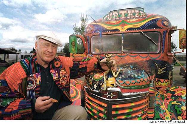 "** FILE **Author Ken Kesey poses in this April 24, 1997, file photo in Springfield, Ore., with his bus, ""Further"", a descendant of the vehicle that carried him and the Merry Pranksters on the 1964 trip immortalized in the Tom Wolfe book, ""The Electric Kool-Aid Acid Test."" A life-sized bronze statue of the late author sitting on a bench reading to three children will be unveiled in Eugene, Ore., Friday, Nov. 14, 2003. (AP Photo/Jeff Barnard,) Ken Kesey Photo: JEFF BARNARD"