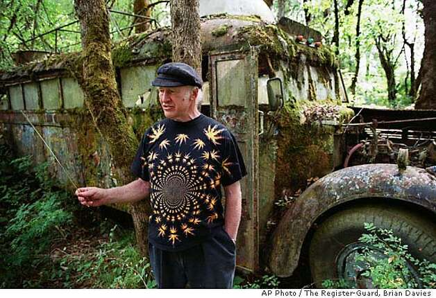 "Author Ken Kesey walks beside the original ""Furthur"" bus, made famous in Tom Wolfe's 1968 book ""The Electric Kool Aid Acid Test"" July 17, 2001 on his farm in Pleasant Hill, Ore. Kesey, who railed against authority in ``One Flew Over the Cuckoo's Nest'' and orchestrated an LSD-fueled bus ride that helped immortalize the psychedelic 1960s, died Saturday. He was 66. (AP Photo/The Register-Guard, Brian Davies) Photo: BRIAN DAVIES"