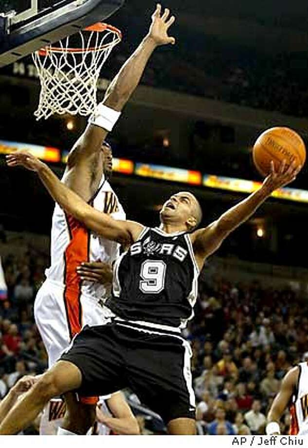 San Antonio Spurs guard Tony Parker (9) is fouled by Golden State Warriors center Erick Dampier as Parker attempts a shot during the first quarter in Oakland, Calif., Saturday, Nov. 5, 2003. (AP Photo/Jeff Chiu) Photo: JEFF CHIU