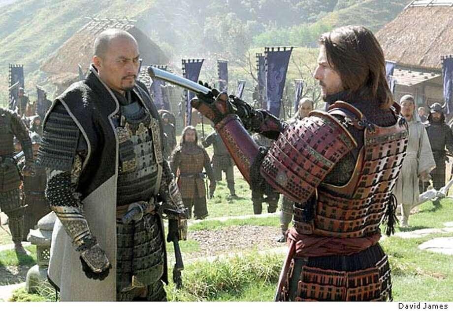 "SAMURAI30_PH.jpg  KEN WATANABE and TOM CRUISE in Warner Bros. Pictures� epic action drama ""The Last Samurai."" Photo by David James Photo: HO"