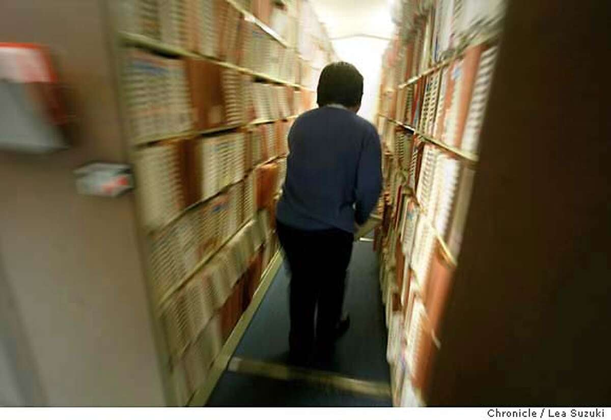 zerofilesxx029_suzuki.JPG A Support Services Clerk puts files away in the Closed Files room at the Federal Building on 11/19/03 in San Francisco, CA. ABSOLUTELY NO FACES OR CONTENTS OR FILE NUMBERS CAN BE SHOWING IN THE PHOTO. THAT WAS THEIR AGREEMENT TO LET US PHOTOGRAPH. Lea Suzuki/ San Francisco Chronicle MANDATORY CREDIT FOR PHOTOG AND SF CHRONICLE/ -MAGS OUT