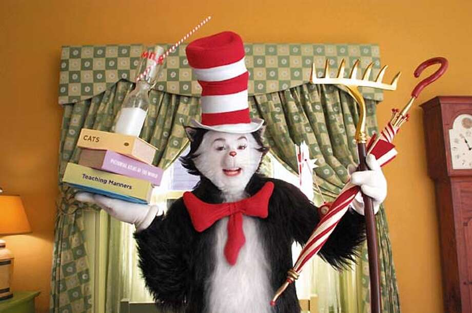 "The star of the new film ""Dr. Seuss' The "", Mike Myers as The Cat, is shown in a scene from the film in this undated publicity photograph. The film opens November 21, 2003 in the United States. REUTERS/Melinda Sue Gordon/Universal Studios REUTERS Photo: HO"