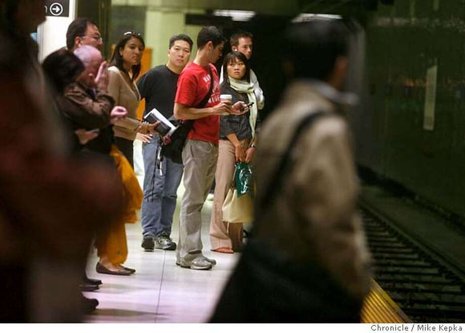 jchurch13108_mk.JPG  Friday morning commuters wait for the Muni car to come their way at Van Ness Station. - San Francisco Mayor Gavin Newsom and top Muni officials announced grand plans to improve the J-church line this past springs but they have since been put on hold after the new T-third line opened. 8/10/07  Mike Kepka/The Chronicle (cq) MANDATORY CREDIT FOR PHOTOG AND SF CHRONICLE/NO SALES-MAGS OUT Photo: Mike Kepka