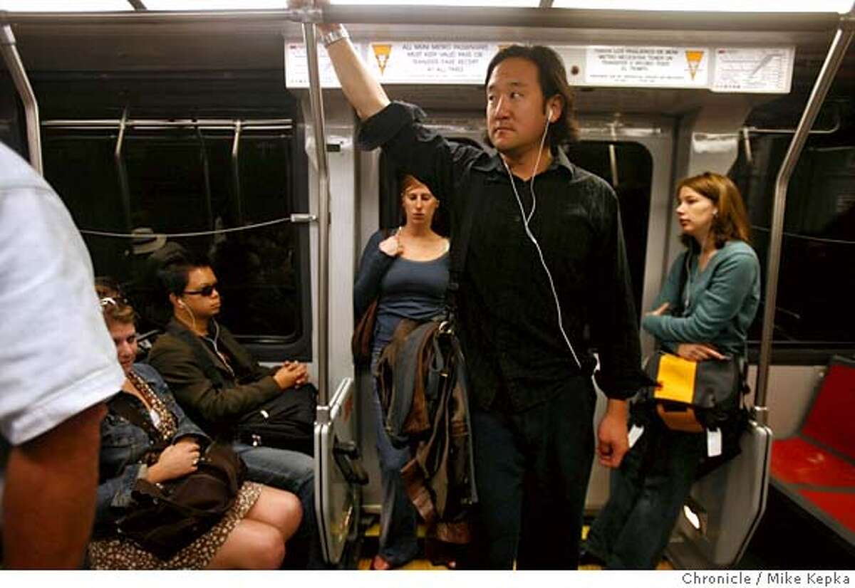 jchurch13149_mk.JPG Michael Wang, Sr. Interactive producer for Charles Schwab, listens to his iPod as he and other Friday morning commuters stand on a full J-Church car as it travels under Market Street. - San Francisco Mayor Gavin Newsom and top Muni officials announced grand plans to improve the J-church line this past springs but they have since been put on hold after the new T-third line opened. 8/10/07 Mike Kepka/The Chronicle (cq) MANDATORY CREDIT FOR PHOTOG AND SF CHRONICLE/NO SALES-MAGS OUT