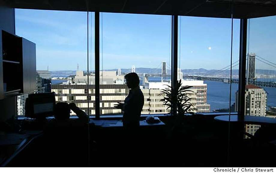 turnarounda0003_cs.jpg Event on 11/25/03 in San Francisco. Employees of GoldenGate Software (cq) enjoy a tremendous view of the SF Bay. The small software company recently moved from Sausalito to the top floors of a high-rise with views of the Bay Bridge at 301 Howard Street, SF. After three years of a near vertical rise in the commercial vacancy rate, companies are again starting to lease space in the city. Much of this is due to the sharp drop in rents, which experts say have finally bottomed out after the long dot-com fallout. Chris Stewart / The Chronicle MANDATORY CREDIT FOR PHOTOG AND SF CHRONICLE/ -MAGS OUT Photo: Chris Stewart
