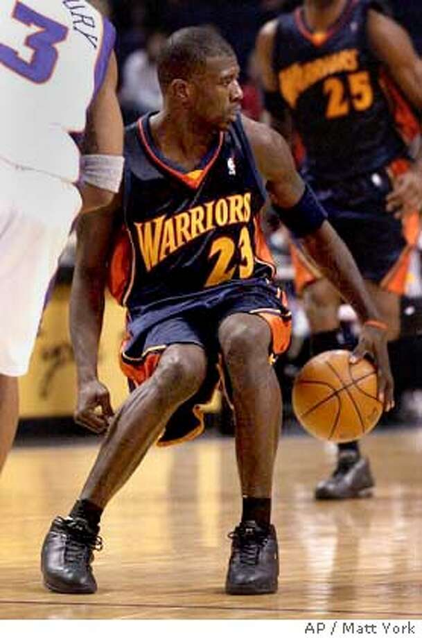 Golden State Warriors' Jason Richardson (23) slows up against the Phoenix Suns' during the fourth quarter Friday, Nov. 28, 2003 at America West Arena in Phoenix. (AP Photo/Matt York) Photo: MATT YORK