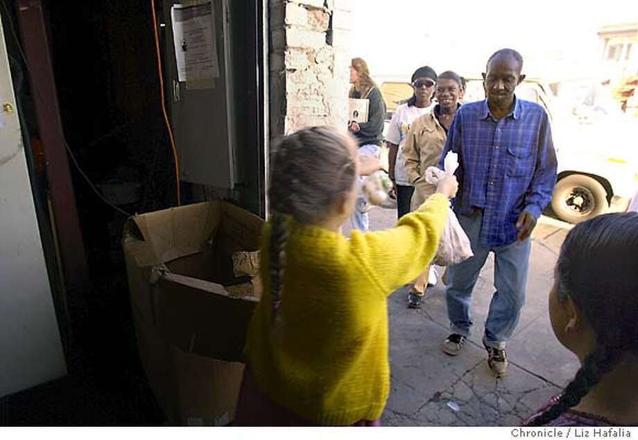 Mother Mary Ann Wright's warehouse where she distributes food and clothing to those in need. A group of kids from San Leandro--East Hills 4H--a homeschool, came to Mother Wright today to do community service. They are handing out groceries at the warehouse. Shot on 11/18/03 in San Francisco. LIZ HAFALIA / The Chronicle Photo: LIZ HAFALIA