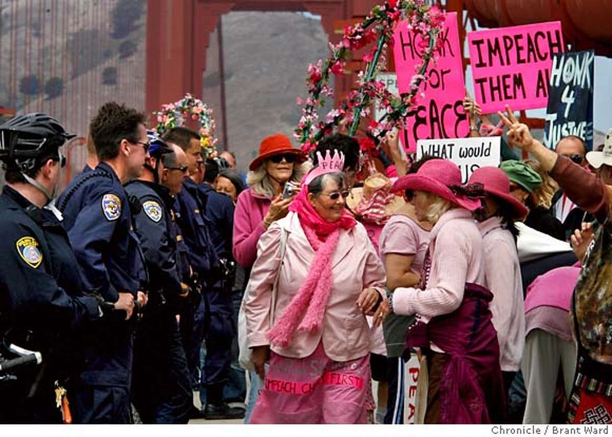 codepink_301.JPG Members of the Ca. Highway Patrol and Golden Gate Bridge police kept the CodePink members off the rail of the bridge during much of their protest. Members of the CodePink group marched across the Golden Gate Bridge Sunday afternoon in preparation for their upcoming hunger strike outside the homes of Sen. Dianne Feinstein and House Speaker Nancy Pelosi. Over 100 activists got the attention of motorists on the bridge, many of whom honked their approval. {By Brant Ward/San Francisco Chronicle}8/12/07