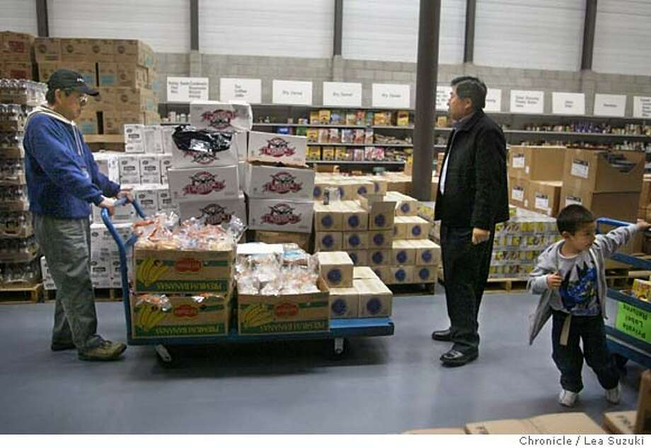 wbfood_24_LS.jpg wbfood_14_LS.JPG  From left: Robert T. Lee, Tony Choi and Ismael Salazar, 4. Lee and Choi load up their cart at the San Francisco Food Bank as Salazar passes by helping his mother with her cart. Lee of the Korean Jesus' Church of San Francisco goes to the San Francisco Food Bank with Tony Choi to select food for the Wednesday Food Pantry at Lincoln Park Presbyterian Chuch at the San Francisco Food Bank in SF, CA on 11/10/03 in San Francisco, CA. The Korean Jesus' Church of San Francisco has been using the facility for the Lincoln Park Presbyterian church since April of this year. Tony volunteered to do the food selection and has been selecting food for the giveaways since June. Photo essay for the day after Thanksgiving on Charities which give away food for families in need. Photo by LEA SUZUKI / The San Francisco Chronicle Photo by Lea Suzuki/ The San Francisco Chronicle. Photo: Lea Suzuki