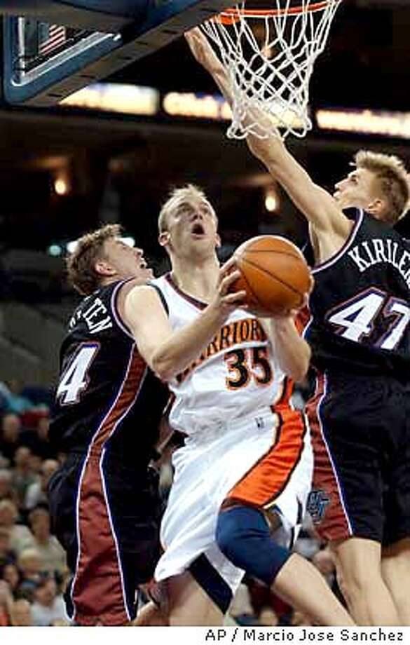 Golden State Warriors forward Brian Cardinal (35) drives to the basket between Utah Jazz center Ben Hanglogten, left, and forward Andre Kirilenko, right, of Russia during the first half Friday, Nov. 7, 2003, in Oakland, Calif. (AP Photo/ Marcio Jose Sanchez) Photo: MARCIO JOSE SANCHEZ