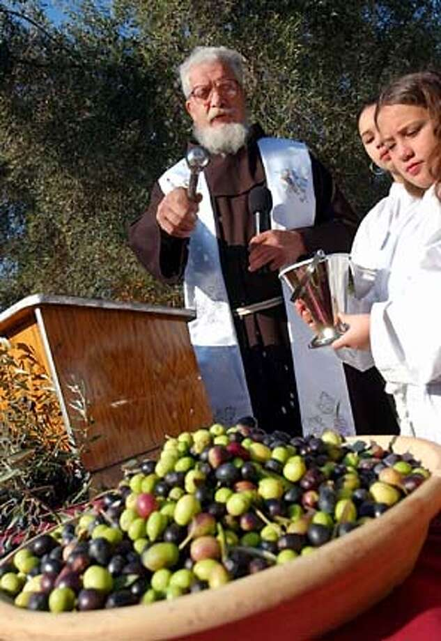 for NBOLIVE28; Father Aurelio of the Order Friar Minor, showing the Blessing of the Olives in 2002, will perform this year's ceremony. , / HO