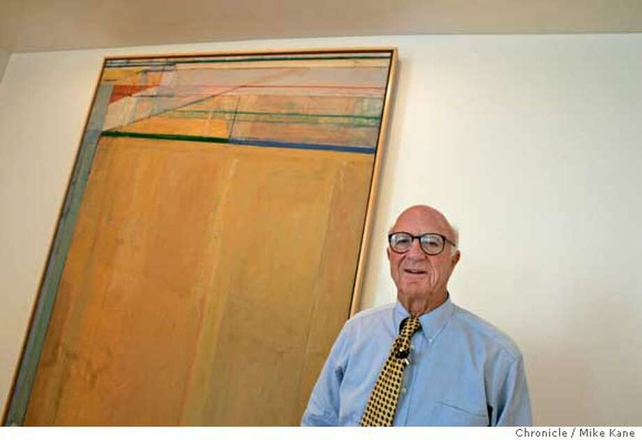 """SFMUSEUM08_002_MBK.JPG  Gap founder Don Fisher stands in front """"Ocean Park Number 67"""" by Richard Diebenkorn, in his office at the Gap headquarters in San Francisco, CA, on Tuesday, August, 7, 2007. photo taken: 8/7/07  Mike Kane / The Chronicle *Don Fisher Photo: MIKE KANE"""