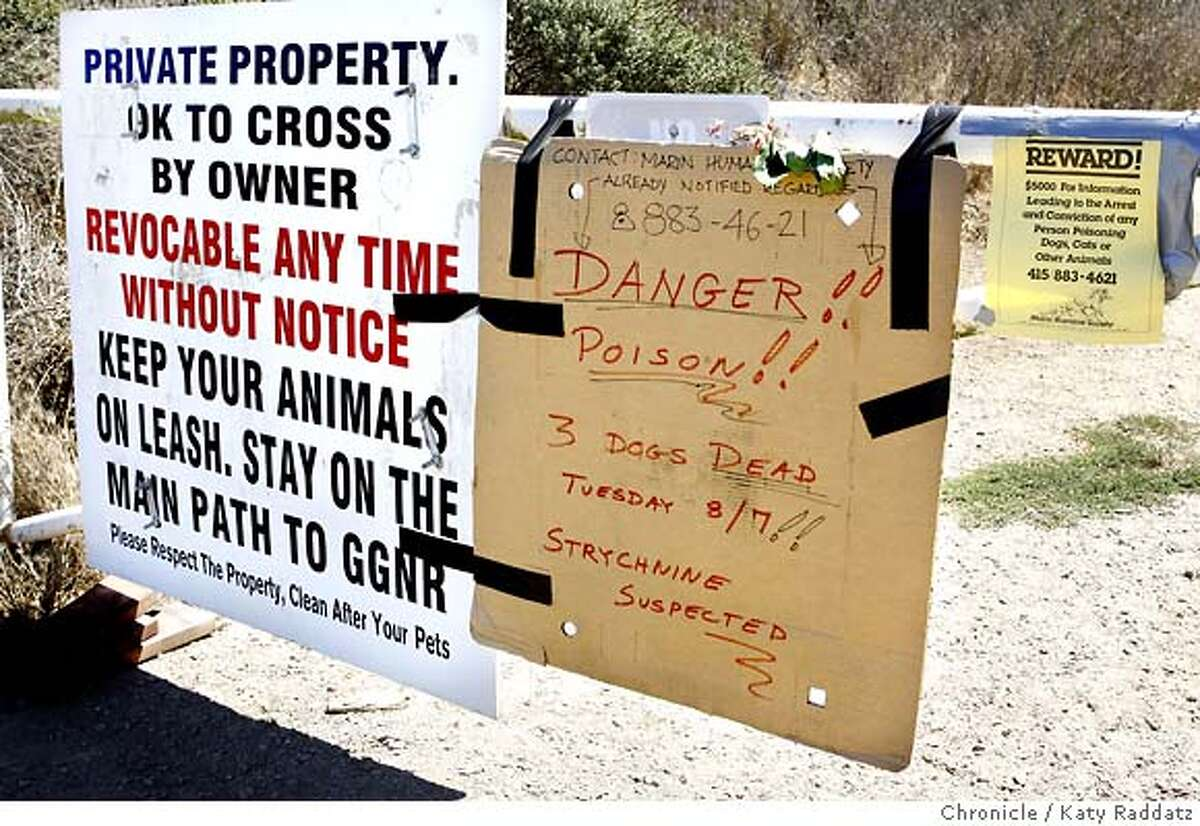 DOGS_004_RAD.jpg SHOWN: A warning sign and reward sign join the private property sign adorning the gate to The Alta Trail, just above Marin City, where three dogs were poisoned last week. (Katy Raddatz/The Chronicle) **
