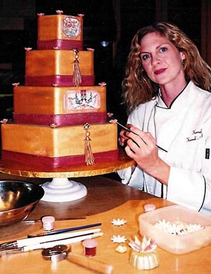 for PNCHOCOLATE28; Hannah Tai with one of the cakes she created using Dagoba fair-trade chocolates. , HO / HO