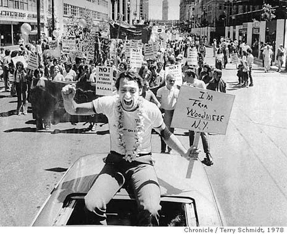 MILK/1978/MN/TS - Gay Freedom Parade Marches Down Market St., activist Supervisor Harvey Milk rides up front. Photo by Terry Schmidt, 1978 Photo: TERRY SCHMIDT