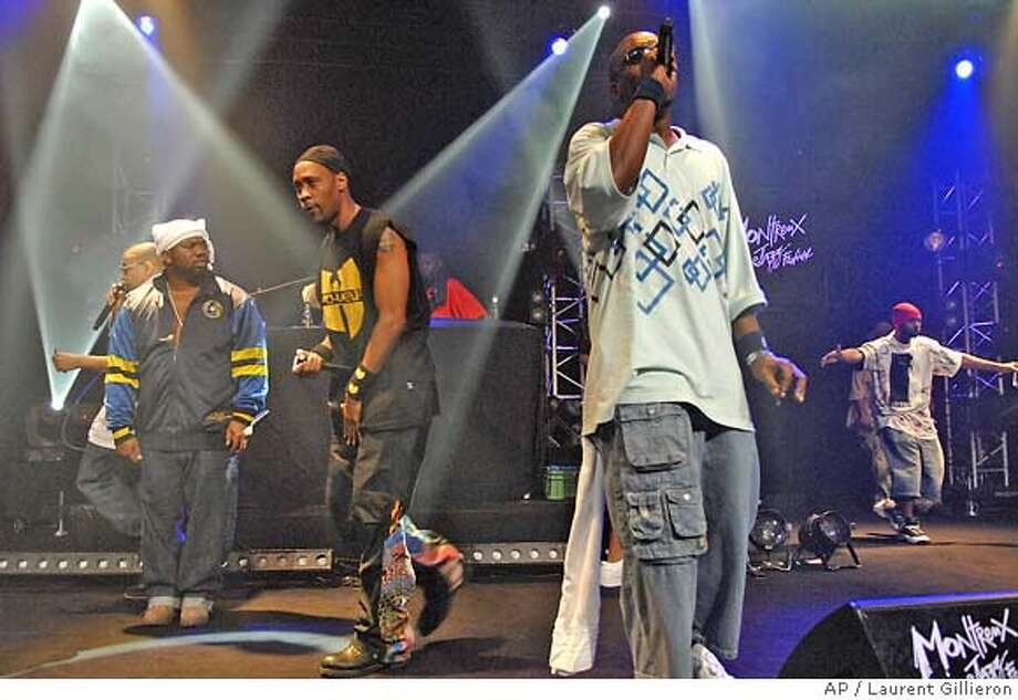 American rappers of 'The Wu-Tang Clan' perform at the Miles Davis Hall at the 41st Montreux Jazz Festival, in Montreux, Switzerland, late Wednesday evening, July 18, 2007. (AP Photo/Keystone, Laurent Gillieron) PHOTO MADE AVAILABLE THURSDAY JULY 19, 2007 Photo: LAURENT GILLIERON