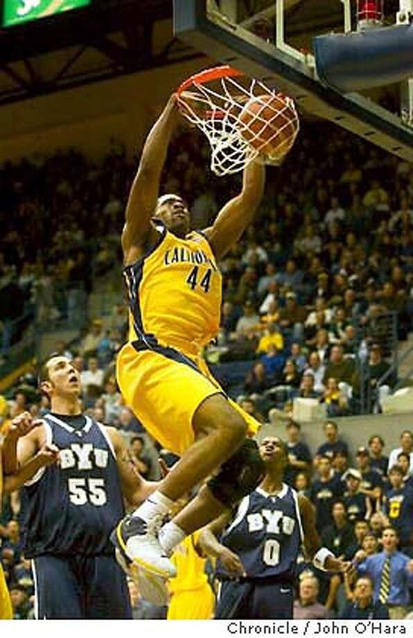 UC Berkeley, Cal Bears V/S BYU Cougars  Cal #44 Leon Powe, slam dunk. The two teams swapped lead frequently in the first half.  BYU #55 is Rafael Araujo  photo John O'Hara Photo: JOHN O'HARA