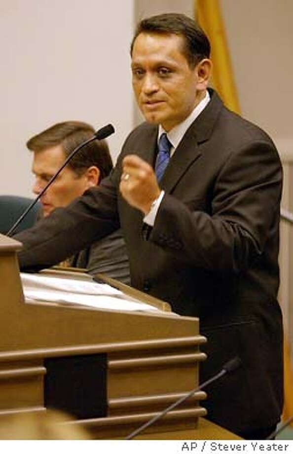 Sen. Gil Cedillo, D-Los Angeles, asks members of the Assembly Transportation Committee to vote in favor of a measure to repeal his bill allowing undocument immigrants to obtain a drivers license, during a hearing at the Capitol, Tuesday, Nov. 25, 2003, in Sacramento, Calif. By a 15-0 vote, the committee voted in favor of the measure by state Sen. Rico Oller, R-San Andreas, left, to repeal Cedillo's law, which was to go into effect Jan. 1. (AP Photo/Stever Yeater) Photo: STEVE YEATER