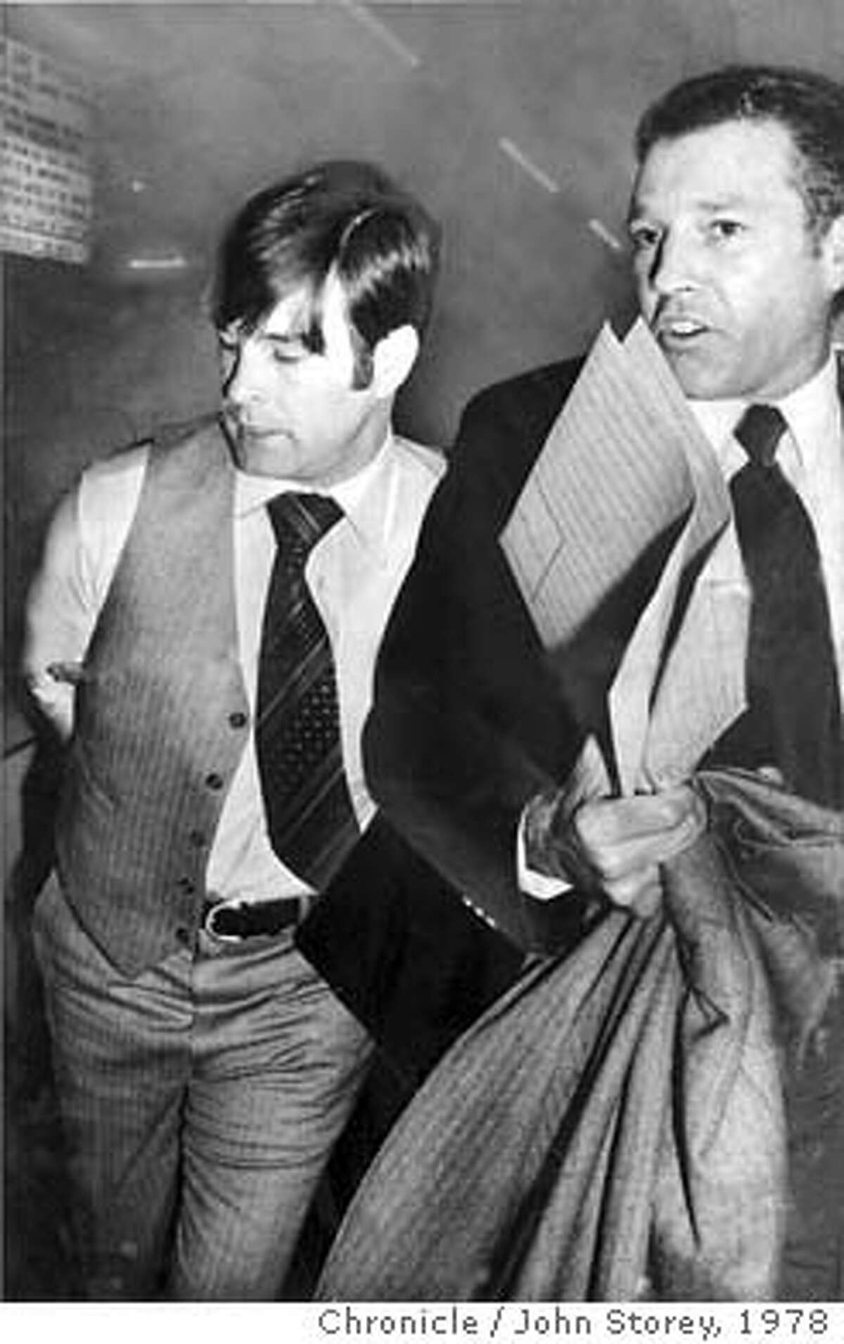 WHITE/B/27NOV78/MN/STOREY - Supervisor Dan White, taken into custody by Inspector Howard Bailey, SFPD, in the basement of the Hall of Justice. White was charged with the murder of Mayor George Moscone and Supervisor Harvey Milk. Photo by John Storey CAT