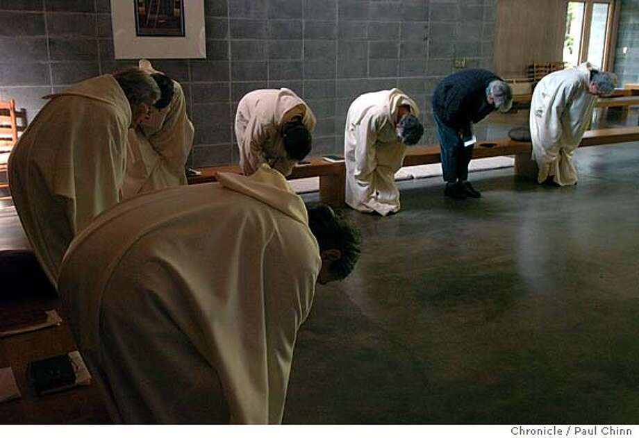 The Cistercian sisters bow during a prayer service in the church before their lunch break. Sisters of the Redwoods Monastery produce creamed honey in Whitethorn on 11/19/03. PAUL CHINN / The Chronicle Photo: PAUL CHINN
