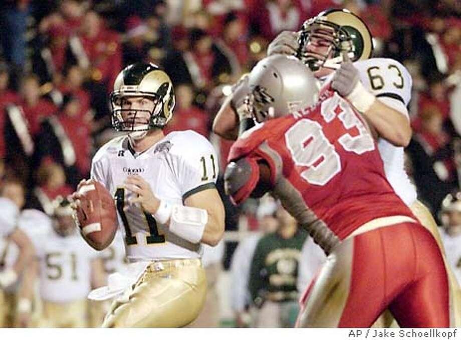 Colorado State quarterback Bradlee Van Pelt (11) looks to pass in the first quarter against Colorado State in Albuquerque, N.M., Friday, Nov. 7, 2003. (AP Photo/Jake Schoellkopf) Photo: JAKE SCHOELLKOPF