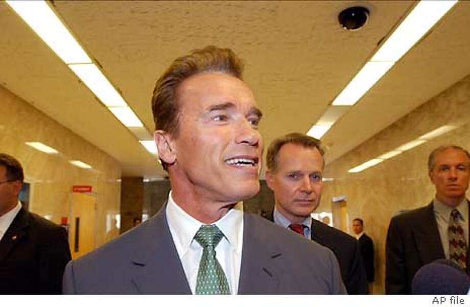California Gov.-elect Arnold Schwarzenegger smiles after a visit to the offices of Gov. Gray Davis and Lt. Gov. Cruz Bustamante in the state Capitol in Sacramento, Calif., Thursday, Oct. 23, 2003. (AP Photo/Paul Sakuma) Gov.-elect Arnold Schwarzenegger is all smiles after a visit to Gov. Gray Davis and Lt. Gov. Cruz Bustamante at the state Capitol. #MainNews#Chronicle#10/25/2003#ALL#5star##0421453159 #MainNews#Chronicle#10/25/2003#ALL#5star##0421453159 #MainNews#Chronicle#10/25/2003#ALL#5star##0421453159 Metro#MainNews#Chronicle#10/25/2003#ALL#5star##0421453159 Metro#MainNews#Chronicle#10/25/2003#ALL#5star##0421453159 Gov.-elect Arnold Schwarzenegger is all smiles after a visit with Gov. Gray Davis and Lt. Gov. Cruz Bustamante at the Capitol. Gov.-elect Arnold Schwarzenegger is all smiles after a visit with Gov. Gray Davis and Lt. Gov. Cruz Bustamante at the Capitol. Photo: PAUL SAKUMA