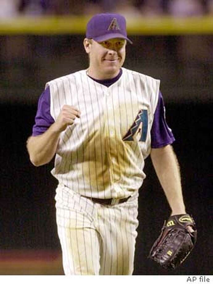Arizona Diamondbacks pitcher Curt Schilling pumps his fist after getting San Francisco Giants batter Jeff Kent to fly out for the final out of the game Friday, July 5, 2002, in Phoenix. Schilling earned his 14th win of the season, pitching a complete game and giving up just one run on four hits and striking out 11 San Francisco batters as Arizona won 2-1. (AP Photo/Paul Connors) Photo: PAUL CONNORS