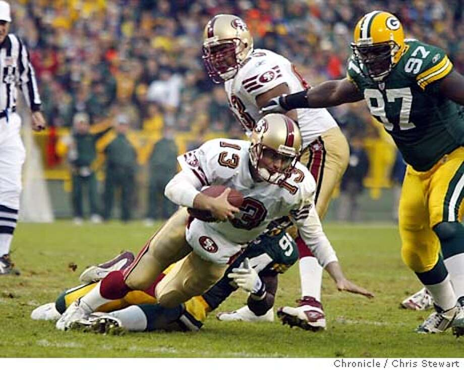 49ers0647_cs.jpg Event on 11/23/03 in Green Bay. The San Francisco 49ers Tim Rattay (13) is sacked at the end of the first quarter by the Packers Kabeer Gbaja-Biamila. The Niners were forced to kick a FG and missed. The 49ers lost to the Green Bay Packers 20-10 at Lambeau Field in Green Bay. Chris Stewart / The Chronicle Tim Rattay is sacked by the Packers' Kabeer Gbaja-Biamila in the first quarter Sunday. Jeff Garcia may be healthy enough to take over against Baltimore. Photo: Chris Stewart
