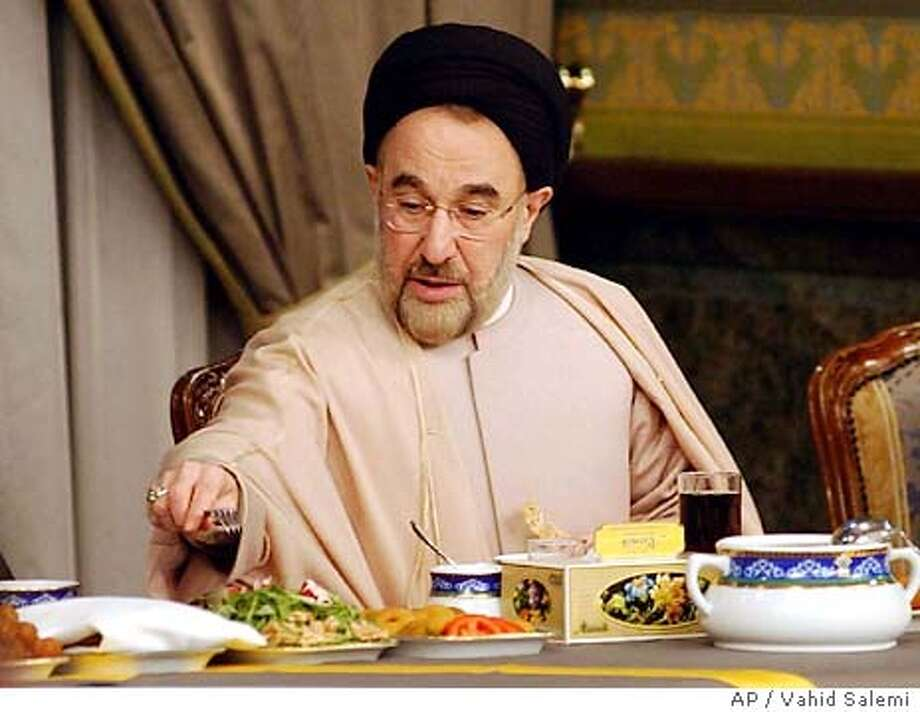 Iranian President Mohammad Khatami, breaks his fast at a fast-breaking meeting with Iranian artists in the Islam's holy month of Ramadan, in Tehran, Iran, Thursday, Nov. 20, 2003. Muslims across the world refrain from eating and drinking from sunrise to sunset during the monthlong fast. (AP Photo/Vahid Salemi) Photo: VAHID SALEMI