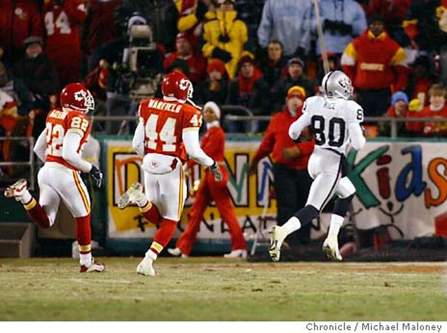 Jerry Rice runs into the endzone for a TD in the 4th quarter. Chiefs #22 Dexter McCleon and #44 Eric Warfield chasing.  Oakland Raiders vs Kansas City Chiefs at Arrowhead Stadium in Kansas City, MO.  Event on 11/23/03 in Kansas City.  MICHAEL MALONEY / The Chronicle Photo: MICHAEL MALONEY