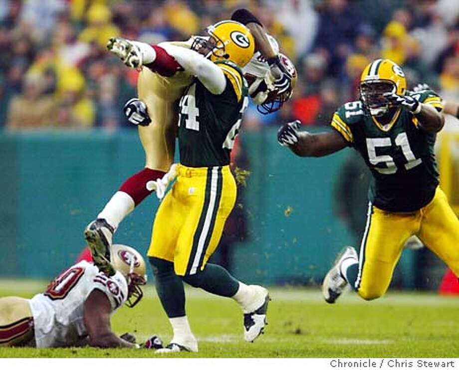 49ers0253_cs.jpg Event on 11/23/03 in Green Bay. The San Francisco 49ers Terrell Owens (81) is stopped for a 4 yard loss on a critical third quarter play by the Packers Antuan Edwards (24) as Torrance Marshall (51) moves in for the kill. The 49ers were forced to punt. The 49ers lost to the Green Bay Packers 20-10 at Lambeau Field in Green Bay. Chris Stewart / The Chronicle Photo: Chris Stewart