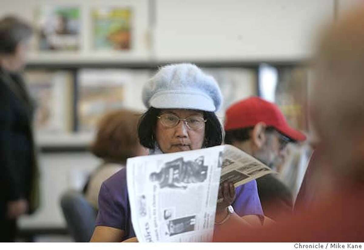 LIBRARY05_094_MBK.JPG Nenita Arellano reads a newspaper during the reopening celebration of Marina branch of SF library in San Francisco, CA, on Saturday, August, 4, 2007. photo taken: 8/4/07 Mike Kane / The Chronicle *Nenita Arellano MANDATORY CREDIT FOR PHOTOG AND SF CHRONICLE/NO SALES-MAGS OUT