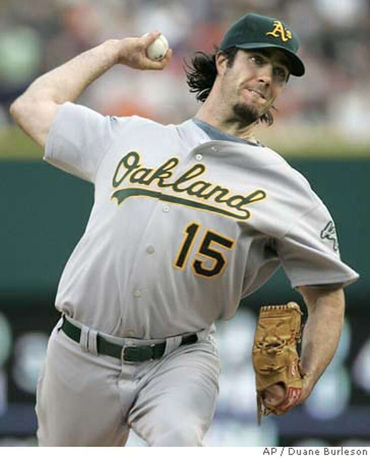 Oakland Athletics starter Dan Haren pitches against the Detroit Tigers in the third inning of a baseball game Saturday, Aug. 11, 2007, in Detroit. (AP Photo/Duane Burleson) Photo: Duane Burleson