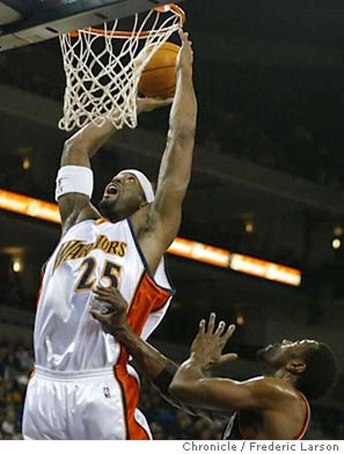 ;Golden State Warriors center Erick Dampier reaches over Portland Traiblazers Qyntel Woods in the first half for a score in Oakland California. The Chronicle; Photo: FREDERIC LARSON