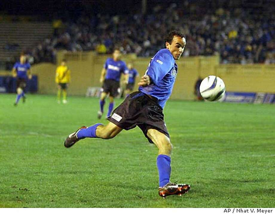 ** FILE ** San Jose Earthquakes Landon Donovan drives down field in the first half against the Los Angeles Galaxy, Sunday night, Nov. 9, 2003, at Spartan Stadium in San Jose, Calif. Donovan, enjoying the San Jose Earthquakes' wild ride through the playoffs, isn't sure he will ever leave Major League Soccer to play for a European team.(AP Photo/San Jose Mercury News, Nhat V. Meyer) MAGS OUT, , Photo: NHAT V. MEYER