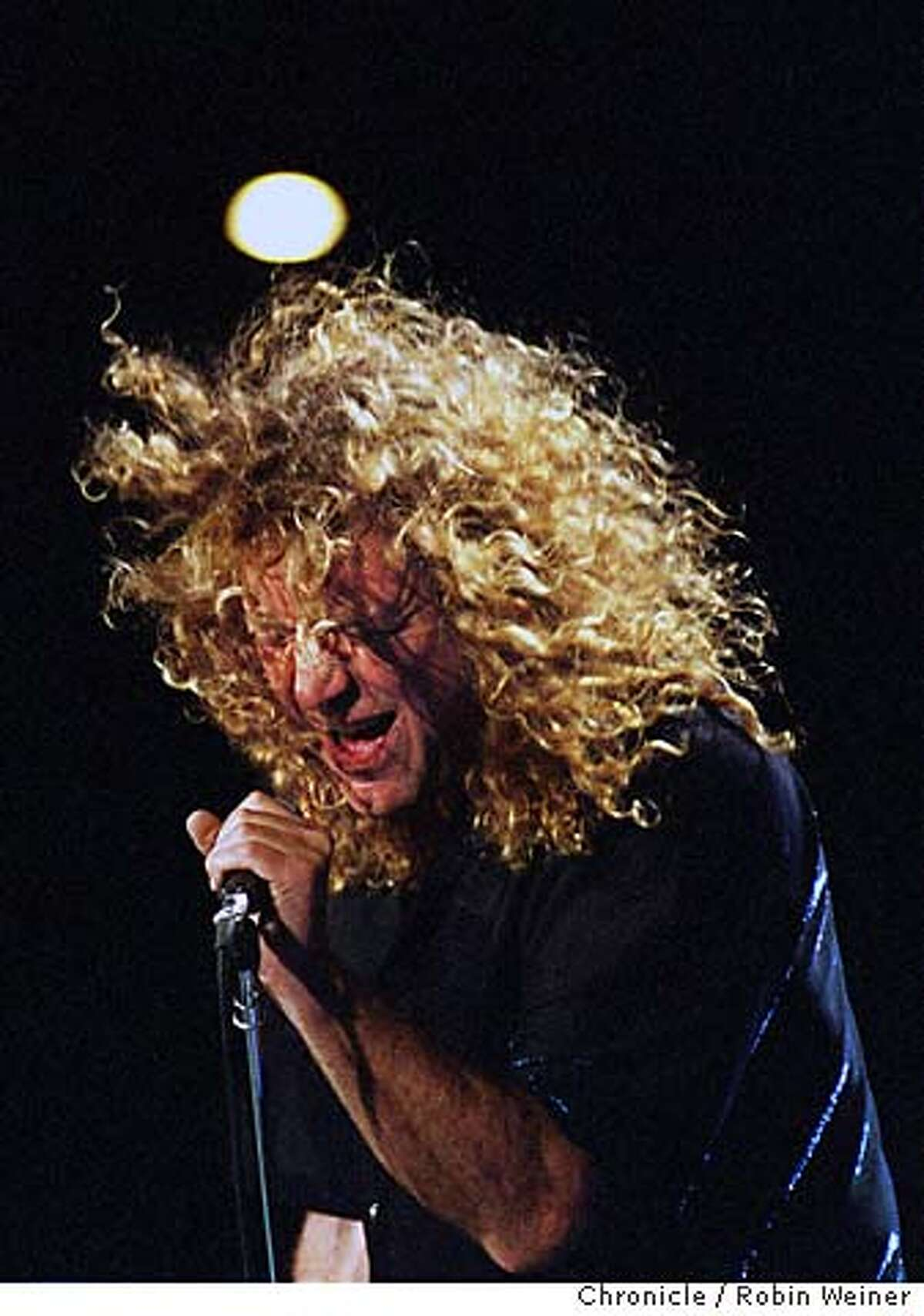 PAGEPLANT3/C/12SEP98/DD/RW Lead singer Robert Plant energizes an opening song during a Led Zeppelin reunion with guitarist Jimmy Page at the Shoreline Amphitheater in Mountain View. BY ROBIN WEINER/FOR THE CHRONICLE ONE TIME USE ONLY CAT