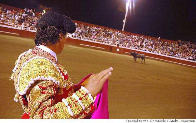 Travel Bloodless Bullfight -- Matador Vitor Mendes, of Portugal, in his sequin suit of lights, eyes his opponent during Our Lady of Miracles bullfight in Gustine, CA. 2006 Photo: Andy Isaacson