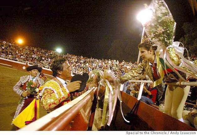 Travel Bloodless Bullfight -- Matador Vitor Mendes receives a bouquet of flowers from the teenage festa queen after his performance. Fans honor the matadors, cavalleiros and forcados by throwing flowers, caps and wineskins. Gustine, CA 2006 Photo: Andy Isaacson