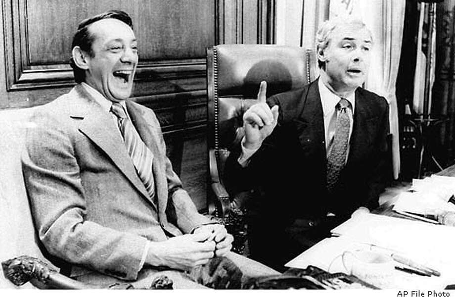 ADVANCE FOR NOV. 27 - FILE - San Francisco Supervisor Harvey Milk, left, and Mayor George Moscone are shown in April 1977 in the mayor's office during the signing of the city's gay rights bill. Friday, Nov. 27, 1998, marks the 20th anniversary of the assassination of Milk and Moscone. (AP Photo/File) ALSO RAN: 12/09/1999 CAT
