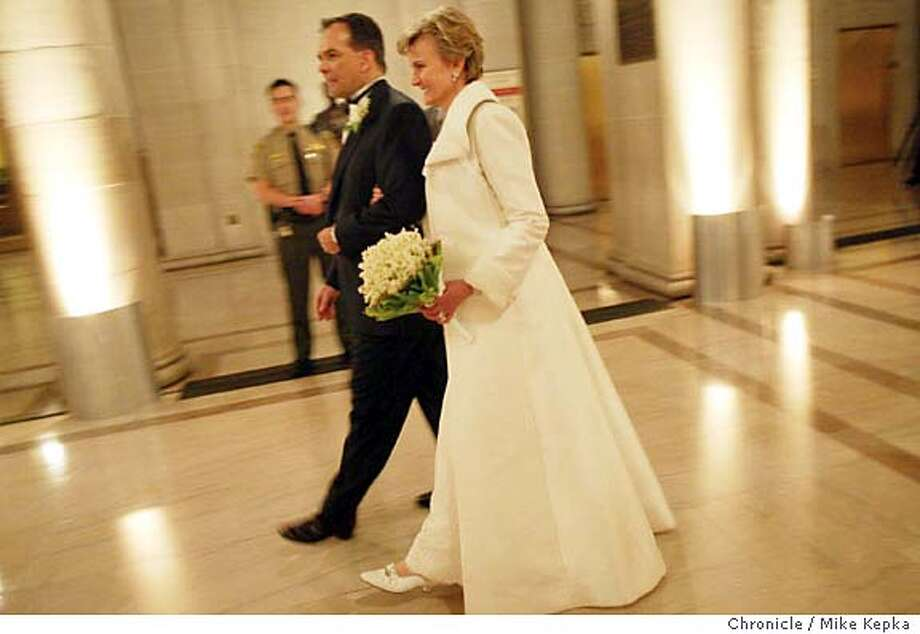 wedding0259_mk.jpg  Gordon Aftles and Linda Rawlins leave city Hall after the ceremony.  Gordon Astles, Head of Cisco Systems in Asia and Linda Rawlings, co-founder of Otis Spunkmeyer cookies. 11/15/03 in San Francisco MIKE KEPKA/The San Francisco Chronicle Photo: MIKE KEPKA