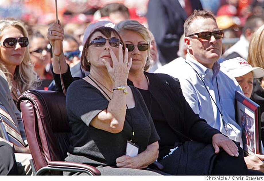 WALSH_PUBLIC_0378_cs.jpg Event on 8/10/07 in San Francisco  Jeri Walsh (center), widow of Bill Walsh, listens to stories about her husband as thousands gathered to celebrate the life of Bill Walsh, former head coach of the San Francisco 49ers, at Monster Park in San Francisco.  Chris Stewart / The Chronicle Walsh memorial, Monster Park Photo: Chris Stewart